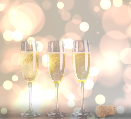 stemware: Close up of a cork against three full glasses of champagne Stock Photo