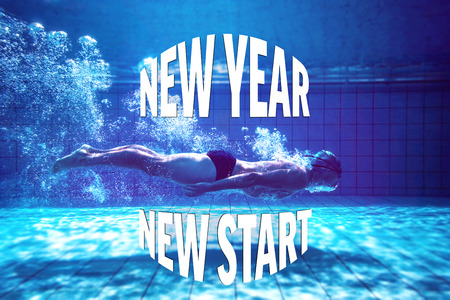 new start: Fit swimmer training by himself against new year new start Stock Photo