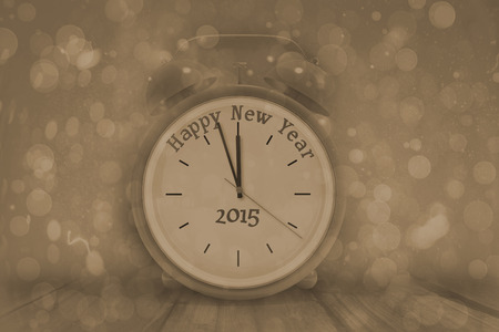 abstract alarm clock: Happy new year in red alarm clock against grey abstract light spot design Stock Photo