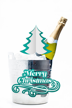 chilling: Merry Christmas message against bottle of champagne chilling in ice bucket Stock Photo