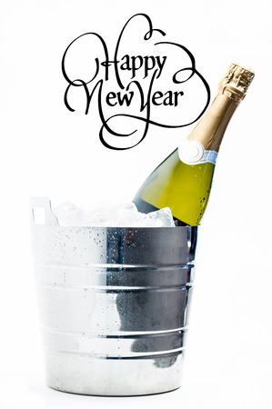 magnum: Happy new year against bottle of champagne chilling in ice bucket