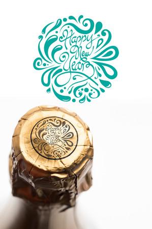 magnum: Elegant happy new year against foil on champagne bottle