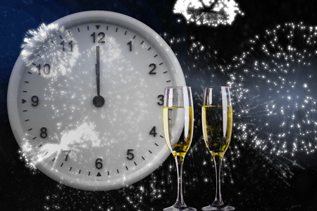 midnight: Clock at midnight against champagne Stock Photo