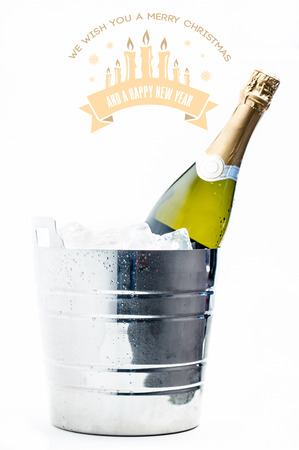 ice bucket: Merry Christmas message against bottle of champagne chilling in ice bucket Stock Photo