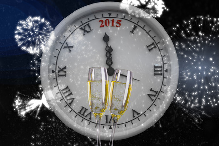 midnight: Clock counting to midnight against champagne Stock Photo