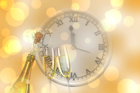 sparkling wine: Clock counting to midnight against sparkling wine Stock Photo
