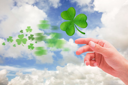 saint patty: Shamrock against blue sky with white clouds