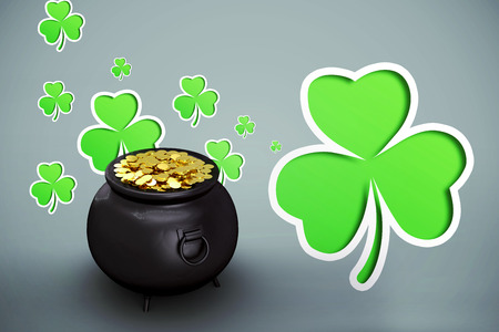 st  patty: pot of gold against green shamrocks on grey background Stock Photo