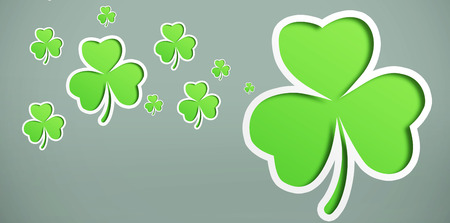 st  patty: Different sized shamrocks on grey background