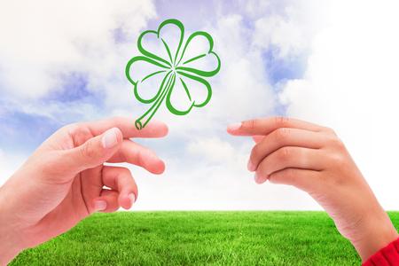saint patty: Shamrock against green field Stock Photo