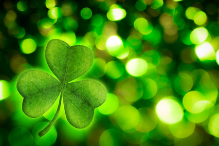 saint patty: Shamrock against green glowing background