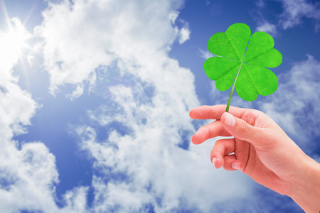 saint patty: Shamrock against bright blue sky with clouds