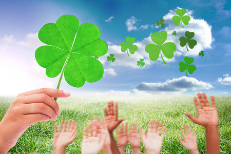 saint patty: Hands raising in the air against sunny landscape