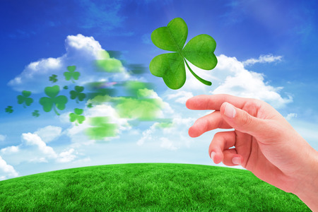 saint patty: Shamrock against green hill under blue sky Stock Photo