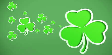 sized: Different sized green shamrocks on green background
