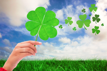 saint patty: Shamrock against green grass under blue sky