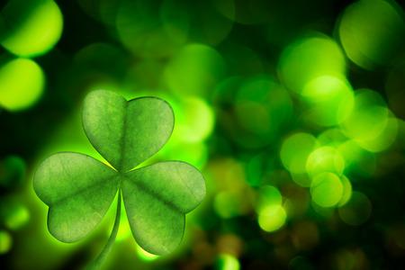 saint patty: Shamrock against green glowing background