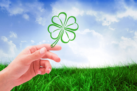 saint patty: Shamrock against field of grass under blue sky