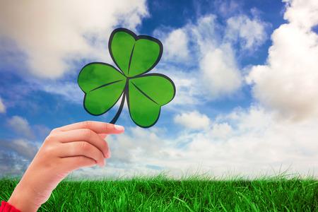 saint patty: Shamrock against green grass under blue sky