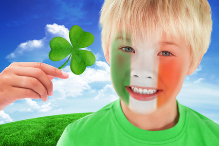 saint patty: Cute irish boy against green hill under blue sky