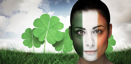face paint: Brunette in irish face paint against blue sky with white clouds