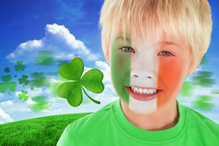 saint patty: Cute irish boy against green hill under blue sky