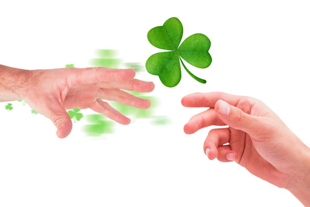 hand out: Businessman holding his hand out against shamrock