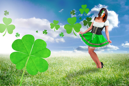 saint patty: Irish girl smiling against sunny landscape Stock Photo
