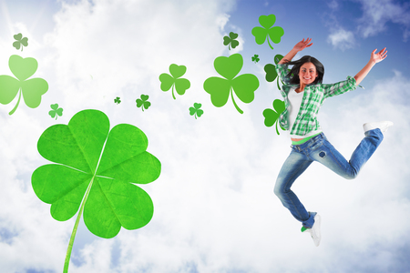 saint patty: Happy brunette against bright blue sky with clouds Stock Photo