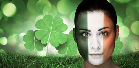 face paint: Brunette in irish face paint against green glowing background