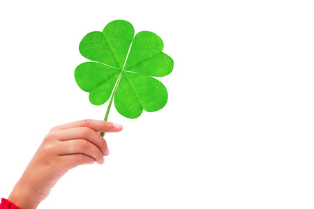 saint patty: Shamrock against hand raised up