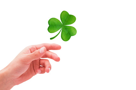 shamrock: Shamrock against hand with raised fingers