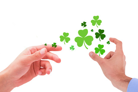 hand out: Businessman holding hand out in presentation against shamrock