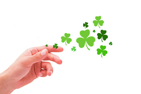 saint patty: Shamrock against hand with raised fingers