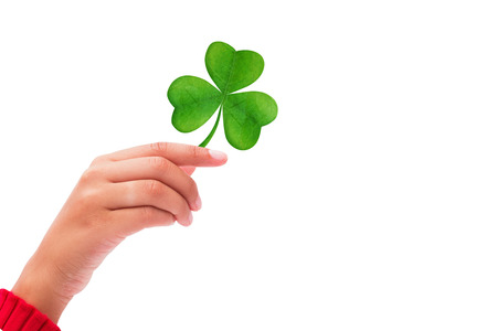 lifted hands: Shamrock against hand raised up