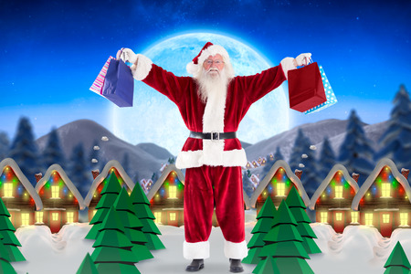 quaint: Santa holds some bags for Chistmas against quaint town with bright moon Stock Photo