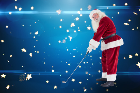 christmas golf: Santa Claus is playing golf  against bright star pattern on blue