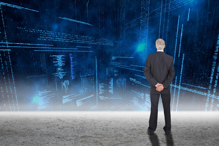 data matrix: Rear view of serious businessman posing against glowing blue data matrix Stock Photo