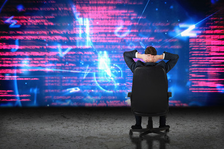 swivel chair: Businessman sitting in swivel chair  against glowing data interface in desert setting Stock Photo