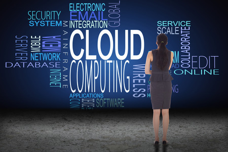 buzzwords: Thoughtful businesswoman against cloud computing buzzwords above desert