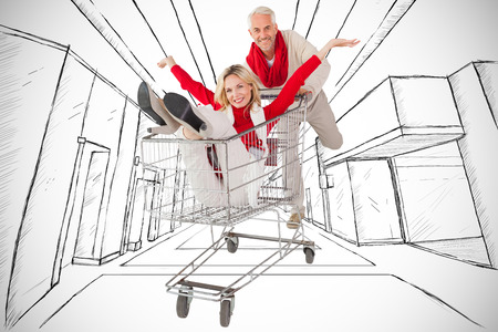 messing: Happy festive couple messing in trolley against white background with vignette