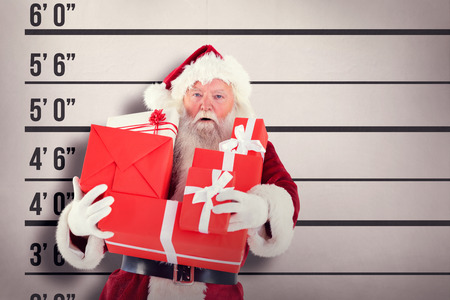 father in law: Santa carries a few presents against mug shot background