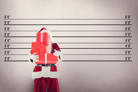 father in law: Santa covers his face with presents against mug shot background Stock Photo