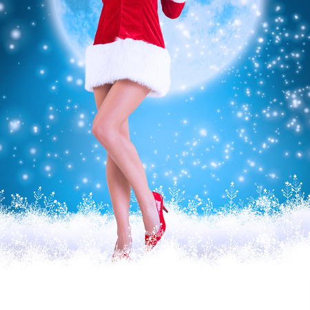 sexy santa girl: Lower half of sexy santa girl against blue background with vignette