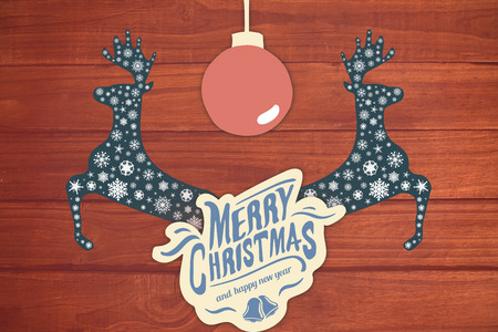 floorboard: Merry christmas message with a ball against overhead of wooden planks