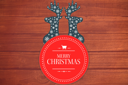 floorboard: Banner and logo saying merry christmas against overhead of wooden planks