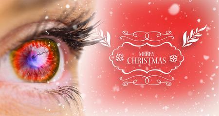 looking ahead: Red glowing eye looking ahead against red vignette Stock Photo