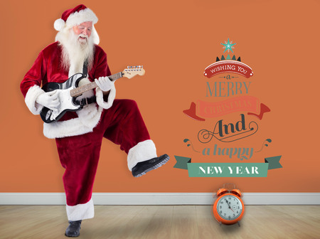 year greetings: Santa Claus has fun with a guitar against room with wooden floor