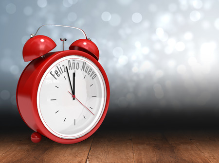 nuevo: Feliz ano nuevo in red alarm clock against shimmering light design over boards Stock Photo