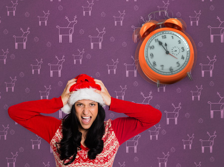 irritated: Irritated woman looking at camera against purple reindeer pattern